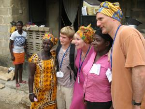 Volunteer family visiting a Ghanaian home