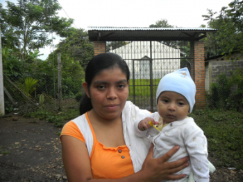 Mother and her child in the marginal community of El Castillo